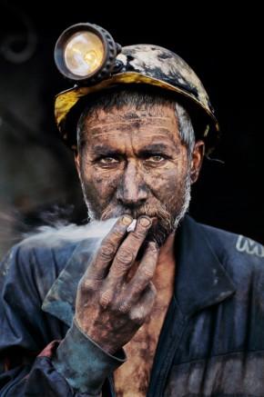 AFGHANISTAN. Pul i Khumri. 2002. Coal Miner smoking a cigarette.