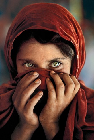 Peshawar, Pakistan, 1984, AFGRL-10002, Sharbat Gula, Afghan girl, in refugee camp near Peshawar, Pakistan. NYC15001, MCS1985002K001 Her eyes have captivated the world since she appeared on our cover in 1985. Now we can tell her story. Afghan Girl: Found National Geographic, April 2002 Sharbat Gula, the Afghan Girl, in Nasir Bagh refugee camp near Peshawar, Pakistan, 1984. Pg. 70, Untold: The Stories Behind the Photographs Untold_book PORTRAITS_book final print_Sao Paulo retouched_Sonny Fabbri 03/04/2015